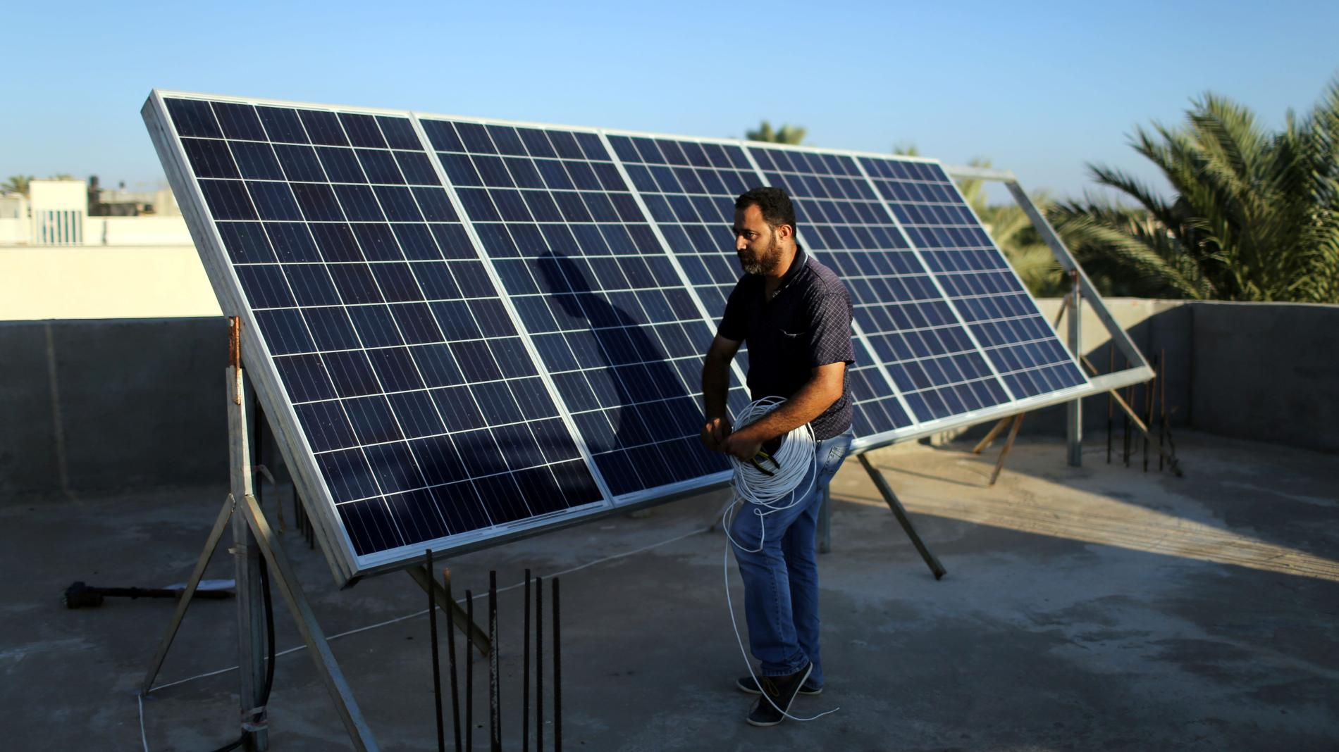 indian technician on a solar roof 02